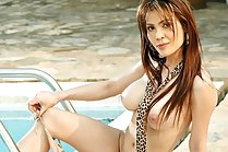 Breasty Tina Phawadee stripping bikini by swimming pool