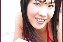 Kieko Kyo flashes tits and pussy in bikini on air mattress