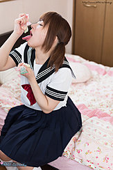 Kogal Mari Rika Seated On Bed Playing With Condon