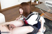 Mari Rika on her knees in uniform pulling mans trousers down exposing his cock