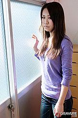 Standing By Window Long Hair Purple Sweater Wearing Jeans