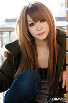Sarina Tsubaki seated on balcony with long hair coloured auburn
