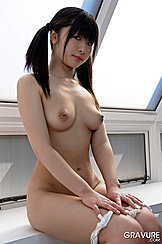 Sitting Down Pigtails To Her Shoulders Pert Little Tits Projecting To Hard Nipples Hands On Thighs Rolling Knickers Down