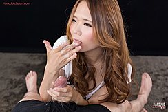 Matsumoto Rena Licking Cum From Her Fingers Holding Spent Cock Long Auburn Hair Streaming Down Over Her Shoulders