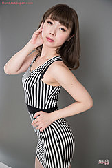 Wearing Striped Dress Hand On Hip