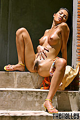 Sitting Nude Hand On Stomach Pointy Nipples Natural Bush