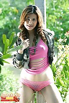 Pulling her jacket close wearing pink top and mesh panties