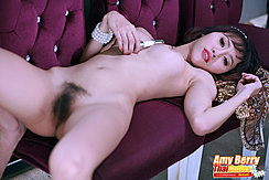 Lying Naked On Sofa Holding Toy Between Her Breasts Hairy Pussy