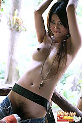 Leaning Back Arms Raisedmlong Hair Over Her Breasts Shorts Pulled Down Exposing Her Hairy Pussy