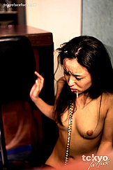 Anna Sakura Kneeling On Floor In Bar Cum Dripping From Her Face Onto Small Breasts