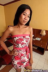 Filipina Trixie Wearing Floral Dress Hand On Hip