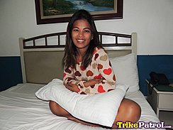 Sitting On Bed Arms Folded Pillow On Her Lap