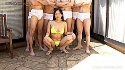 Japanese Girl Kay In Yellow Bikini Wearing High Heels Squatting In Front Of Group Of Men