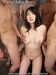 Megumi Sitting Between Two Naked Men Rubbing Their Cocks Against Her Tits