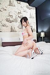 Kyouno Yui Kneeling On Bed Wearing Bra And Panties Hand On Thigh In High Heels