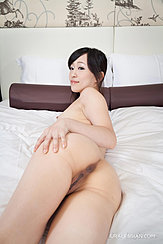 Nude On Bed Lying On Her Side Hand On Hip Exposing Her Pussy