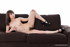 Lying Naked On Sofa Fondling Small Breasts Legs Open Showing Her Hairy Pussy In High Heels