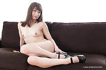 Seated on sofa naked small tits wearing high heels